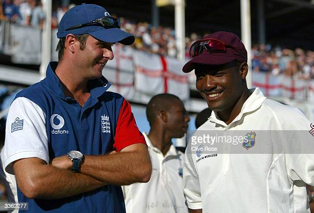 Michael Vaughan talks to Brian Lara at the end of day five of the 4th Test match between the West Indies and England at the Recreation Ground, on...