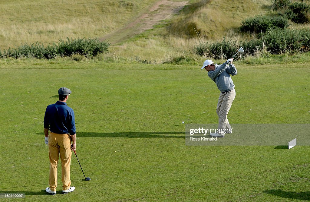 Michael Vaughan the former England cricket captain watches another former England captain Andrew Strauss tee off on the par four 6th hole during the third round of the 2013 Alfred Dunhill Links Championship at the Kingsbarns Golf Club on September 28, 2013 in Kingsbarns, Scotland.