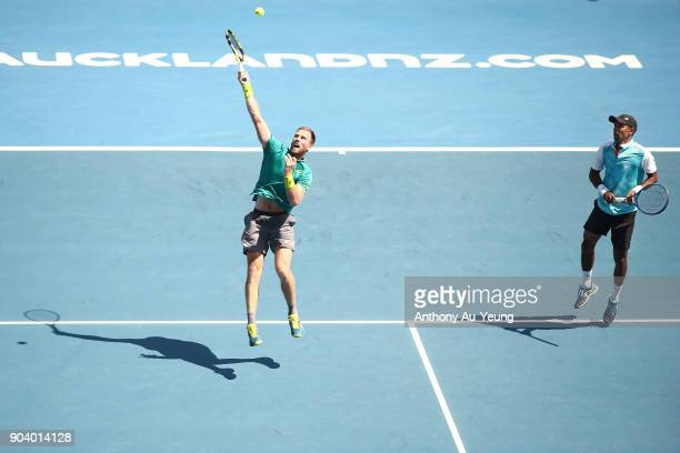 Michael Venus of New Zealand and Raven Klaasen of South Africa play a shot in their doubles semi final match against Max Mirnyi of Belarus and...