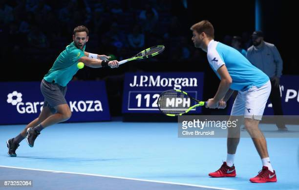 Michael Venus of New Zealand and Ryan Harrison of the United States in action against Henri Kontinen of Finland and John Peers of Australia in their...