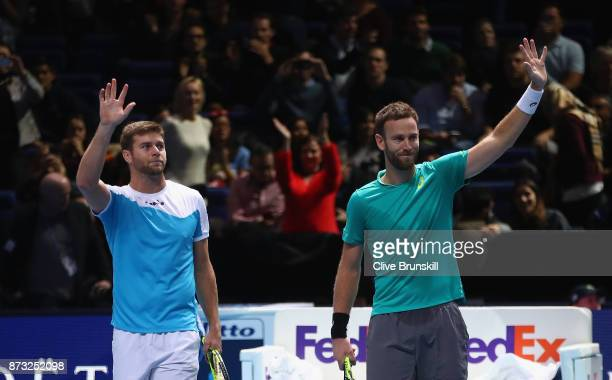 Michael Venus of New Zealand and Ryan Harrison of the United States celebrate to the crowd after their straight sets victory against Henri Kontinen...
