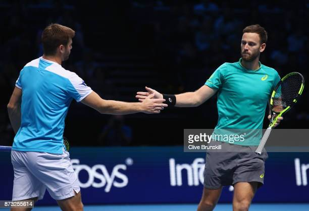 Michael Venus of New Zealand and Ryan Harrison of the United States celebrate a point during their straight sets victory against Henri Kontinen of...