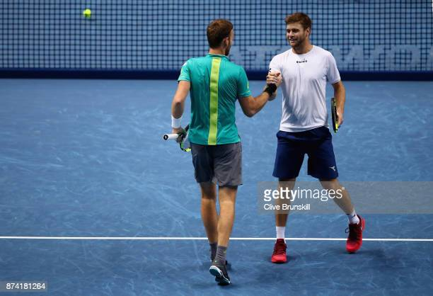 Michael Venus of New Zealand and Ryan Harrison of The United States celebrate victory during the doubles match against Nicolas Mahut of France and...