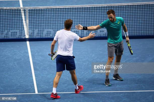 Michael Venus of New Zealand and Ryan Harrison of The United States in action during the doubles match against Nicolas Mahut of France and...