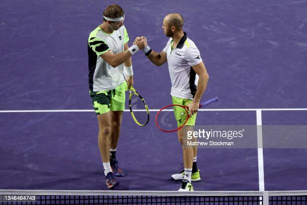 Michael Venus of New Zealand and Tim Puetz of Germany celebrate match point while playing Kevin Krawietz of Germany and Horia Tecau of Romania during...
