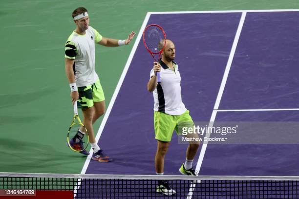 Michael Venus of New Zealand and Tim Puetz of Germany celebrate their win against Kevin Krawietz of Germany and Horia Tecau of Romania during the BNP...