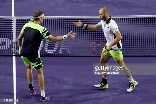 Michael Venus of New Zealand and Tim Puetz of Germany celebrate while playing Kevin Krawietz of Germany and Horia Tecau of Romania during the BNP...