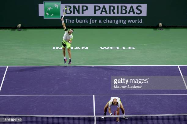 Michael Venus of New Zealand and Tim Puetz of Germany play Kevin Krawietz of Germany and Horia Tecau of Romania during the BNP Paribas Open at the...
