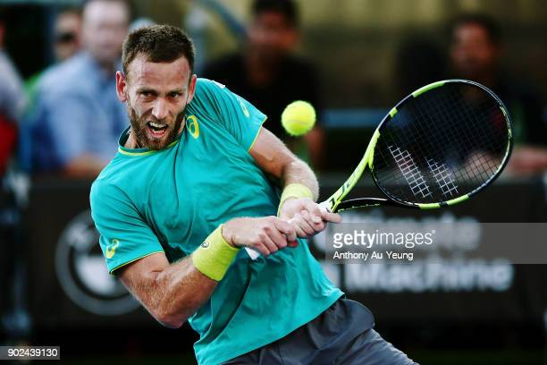 Michael Venus of New Zealand plays a backhand in his first round match against Roberto Bautista Agut of Spain during day one of the ASB Men's Classic...