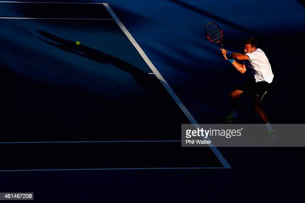 Michael Venus of New Zealand plays a backhand in his singles match against Alejandro Gonzalez of Colombia during day two of the 2015 Heineken Open...