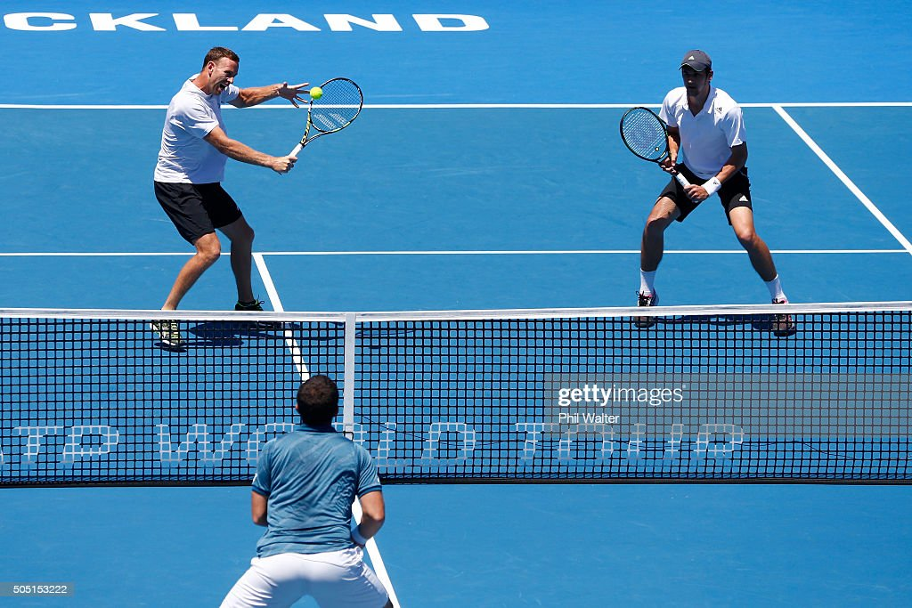Michael Venus of New Zealand (L) plays a backhand with Mate Pavic of Croatia against Eric Butorac and Scott Lipsky of the USA in their doubles final on day six of the ASB Classic at the Stanley Street Tennis Centre on January 16, 2016 in Auckland, New Zealand.