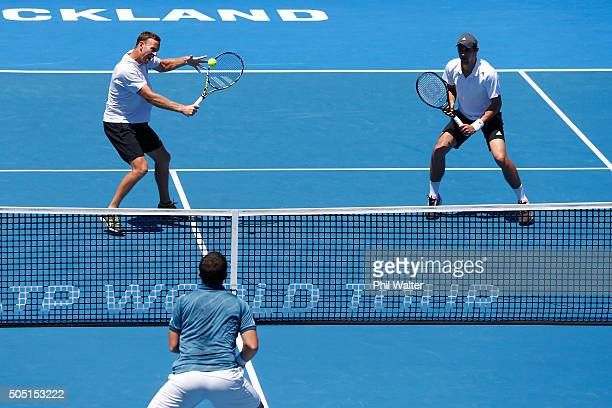 Michael Venus of New Zealand plays a backhand with Mate Pavic of Croatia against Eric Butorac and Scott Lipsky of the USA in their doubles final on...
