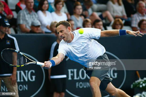 Michael Venus of New Zealand plays a forehand against Benoit Paire of France on Day 8 of the ASB Classic on January 12 2016 in Auckland New Zealand
