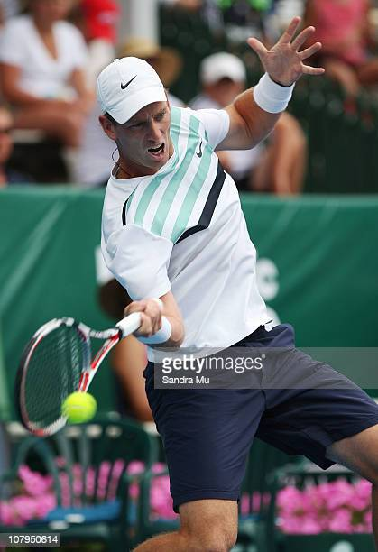 Michael Venus of New Zealand plays a forehand during his match against Tommy Robredo of Spain on day one of the Heineken Open at ASB Tennis Centre on...