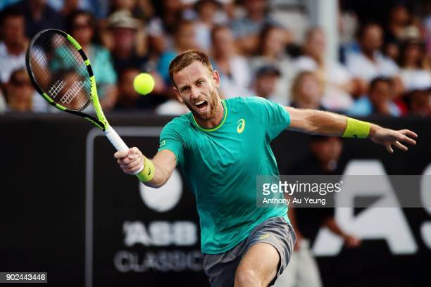 Michael Venus of New Zealand plays a forehand in his first round match against Roberto Bautista Agut of Spain during day one of the ASB Men's Classic...
