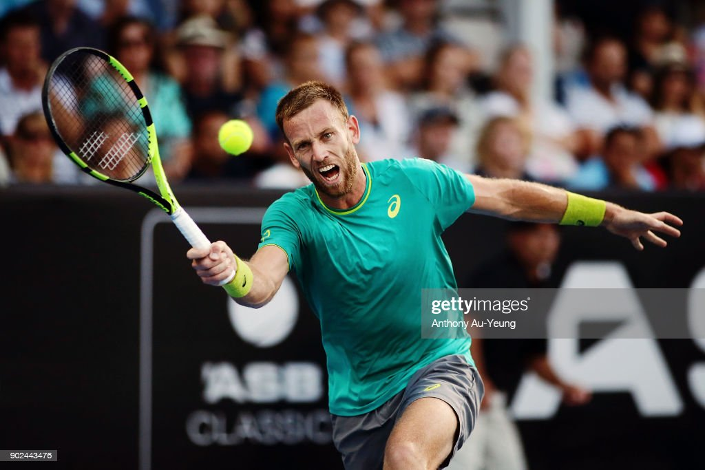 Michael Venus of New Zealand plays a forehand in his first round match against Roberto Bautista Agut of Spain during day one of the ASB Men's Classic at ASB Tennis Centre on January 8, 2018 in Auckland, New Zealand.