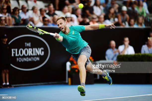 Michael Venus of New Zealand plays a shot in his first round match against Roberto Bautista Agut of Spain during day one of the ASB Men's Classic at...