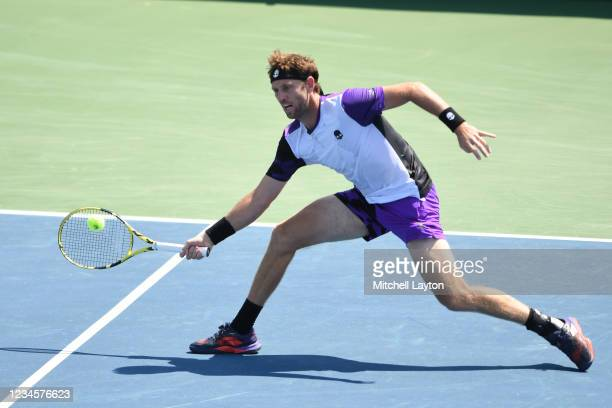 Michael Venus of New Zealand returns a shot during a doubles final match against Raven Klaasen of Brazil and Ben McLachlan of Japan on Day 9 during...