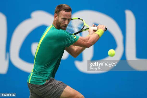 Michael Venus of New Zealand returns a shot during the match against Zihao Xia of China during Qualifying first round of 2017 ATP Chengdu Open at...