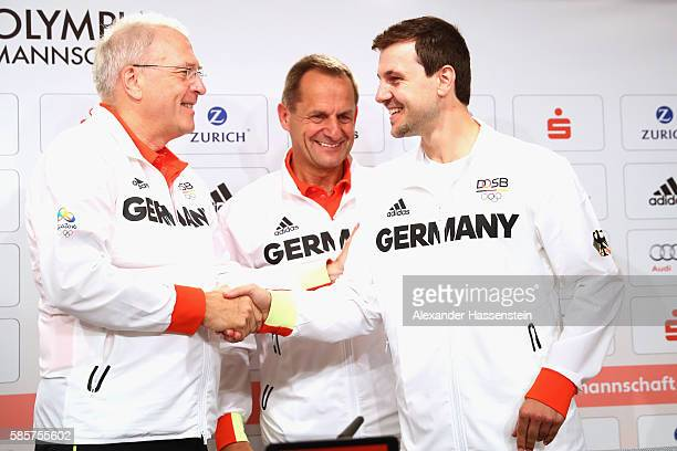 Michael Vesper CEO of the German Olympic Sports Confederation and Alfons Hoermann German Olympic Association president shake hands with table tennis...