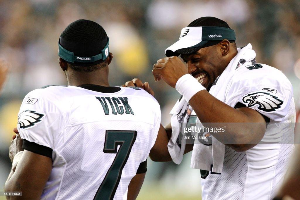 Michael Vick and Donovan McNabb of the Philadelphia Eagles share a ... c9f4bd396