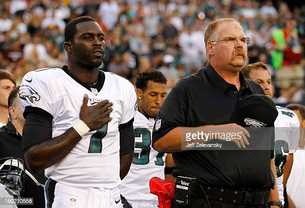 Michael Vick and head coach Andy Reid of the Philadelphia Eagles observe a moment of silence in memory of Reid's son Garrett before a preseason game...