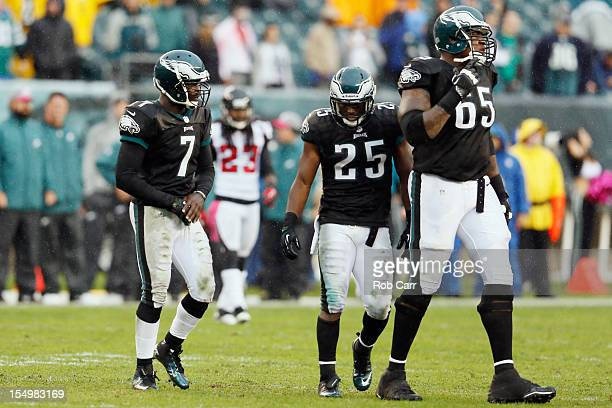 Michael Vick, LeSean McCoy, and King Dunlap of the Philadelphia Eagles walk back to the huddle during the second half against the Atlanta Falcons at...