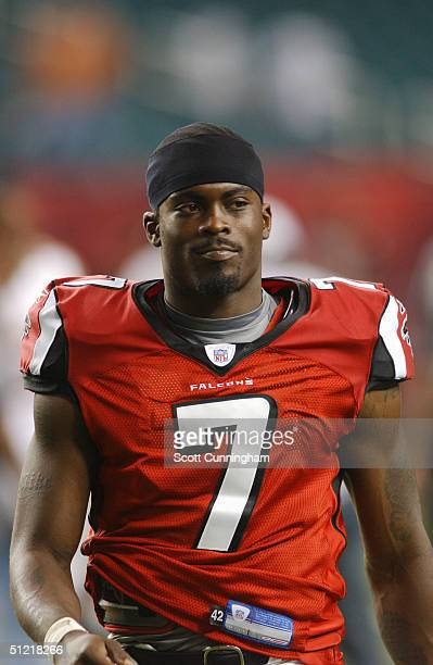 Michael Vick of the Atlanta Falcons looks on from the sideline against the Minnesota Vikings during the preseason NFL game on August 20 2004 at The...