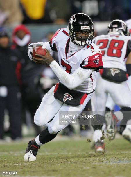 Michael Vick of the Atlanta Falcons rolls out to pass during the NFC Championship game against the Philadelphia Eagles at Lincoln Financial Field on...