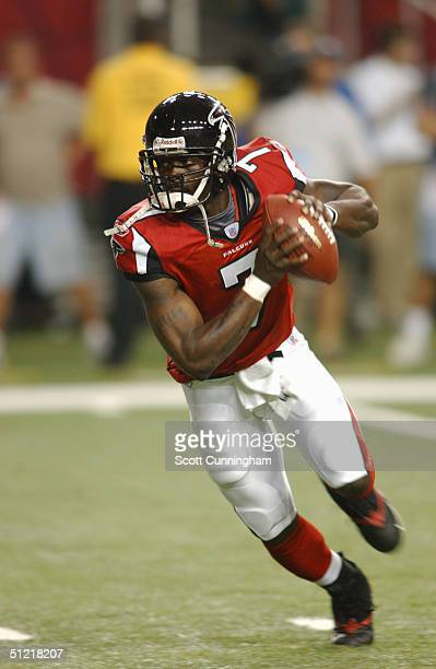 Michael Vick of the Atlanta Falcons runs with the ball against the Minnesota Vikings during the preseason NFL game on August 20 2004 at The Georgia...