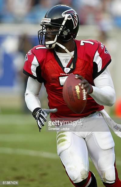 Michael Vick of the Atlanta Falcons runs with the ball during their game against the Carolina Panthers on October 3, 2004 at Bank of America Stadium...