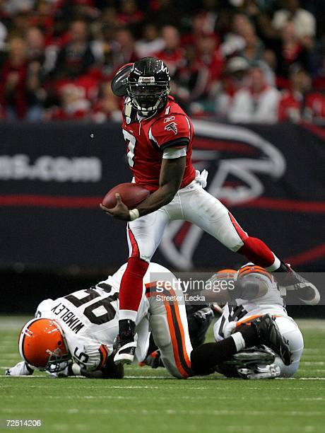 Michael Vick of the Atlanta Falcons runs with the ball during their game against the Cleveland Browns at the Georgia Dome November 12 2006 in Atlanta...