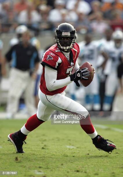 Michael Vick of the Atlanta Falcons scrambles against the Carolina Panthers on October 3, 2004 at Bank of America Stadium in Charlotte, North...