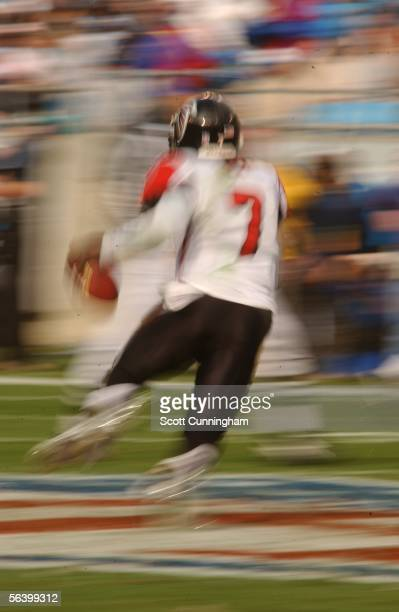 Michael Vick of the Atlanta Falcons scrambles against the Carolina Panthers on December 4, 2005 at Bank of America Stadium in Charlotte, North...