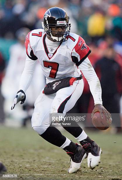Michael Vick of the Atlanta Falcons scrambles against the Philadelphia Eagles during the NFC Championship game at Lincoln Financial Field on January...