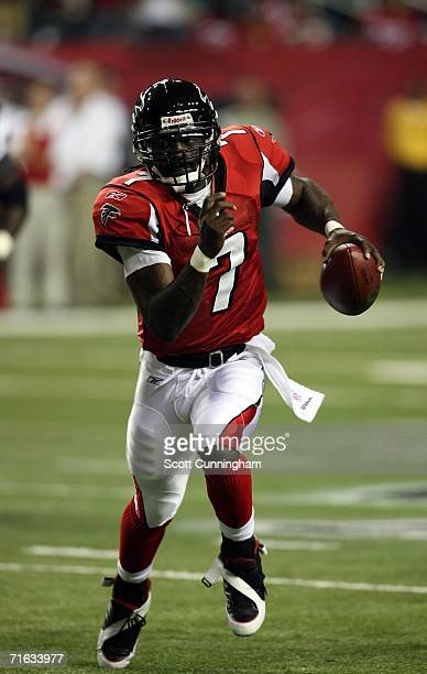 Michael Vick of the Atlanta Falcons scrambles against the New England Patriots at the Georgia Dome on August 11, 2006 in Atlanta, Georgia. The...