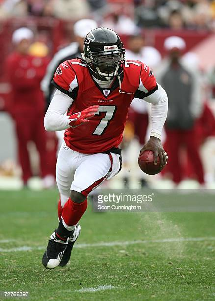 Michael Vick of the Atlanta Falcons scrambles against the Washington Redskins at the FedEx Field on December 3 2006 in Landover Maryland The Falcons...
