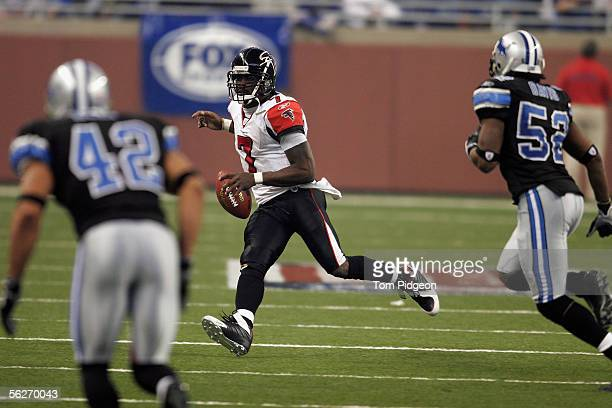 Michael Vick of the Atlanta Falcons scrambles for yards against the Detroit Lions during a NFL game at Ford Field on November 24, 2005 in Detroit,...