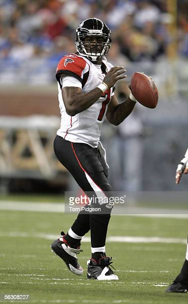 Michael Vick of the Atlanta Falcons throws a pass during the NFL game with the Detroit Lions at Ford Field on November 24, 2005 in Detroit, Michigan....