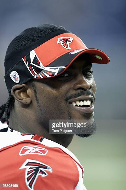 Michael Vick of the Atlanta Falcons watches from the sideline during the NFL game with the Detroit Lions at Ford Field on November 24, 2005 in...