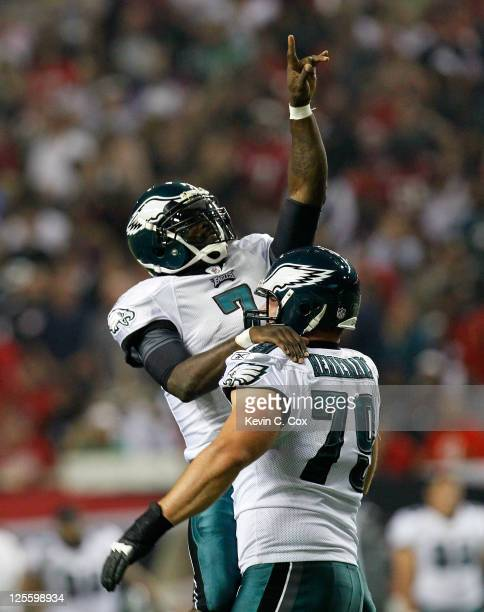 Michael Vick of the Philadelphia Eagles celebrates a touchdown with Todd Herremans against the Atlanta Falcons at Georgia Dome on September 18 2011...