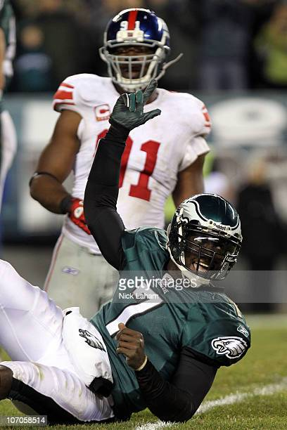Michael Vick of the Philadelphia Eagles celebrates after throwing converting on a two point conversion in the fourth quarter as Justin Tuck of the...