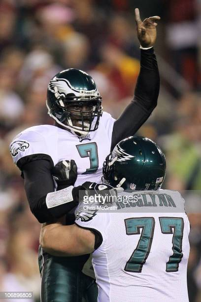 Michael Vick of the Philadelphia Eagles celebrates with team mate Mike McGlynn after throwing his teams first touchdown against the Washington...