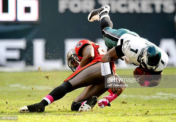 Michael Vick of the Philadelphia Eagles collides with Aqib Talib of the Tampa Bay Buccaneers at Lincoln Financial Field on October 11 2009 in...