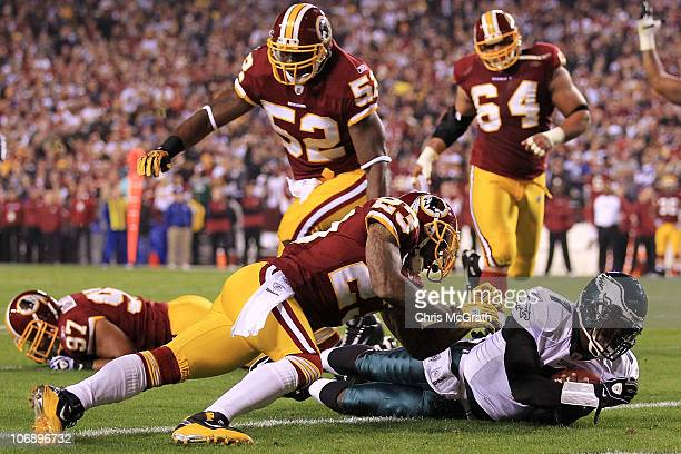 Michael Vick of the Philadelphia Eagles dives over to score a touchdown against the Washington Redskins on November 15 2010 at FedExField in Landover...