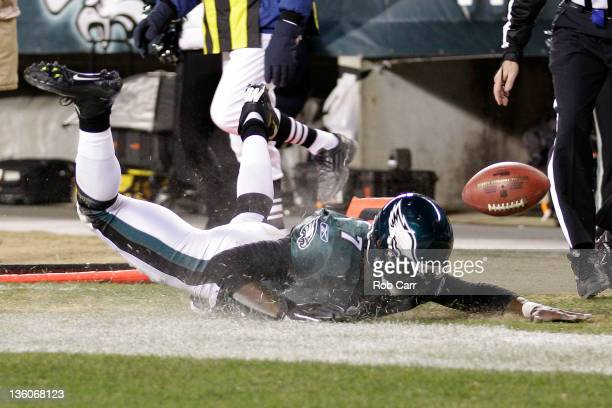 Michael Vick of the Philadelphia Eagles falls into the endzone for a first half touchdown against the New York Jets at Lincoln Financial Field on...