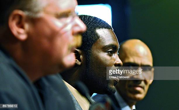 Michael Vick of the Philadelphia Eagles gets interviewed by the media as Head Coach Andy Reid and Tony Dungy look on August 14 2009 at the NovaCare...