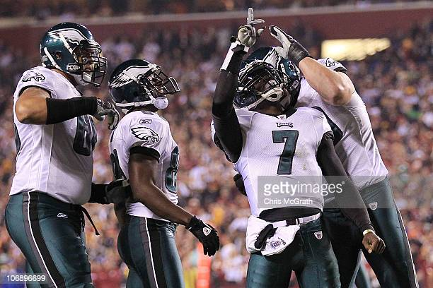 Michael Vick of the Philadelphia Eagles is congratulated by team mate Todd Herremans after scoring a touchdown against the Washington Redskins on...