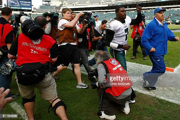 Michael Vick of the Philadelphia Eagles is swamped by media as he leaves the field after defeating the Kansas City Chiefs on September 27, 2009 at...