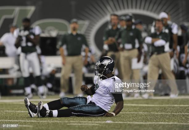 Michael Vick of the Philadelphia Eagles is tackled by the New York Jets on September 3, 2009 at Giants Stadium in East Rutherford, New Jersey. The...